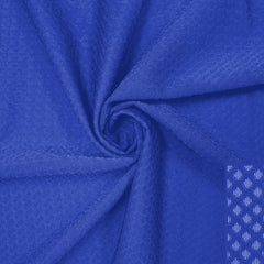 A swirled piece of Hive Textured Spandex in the color royal.