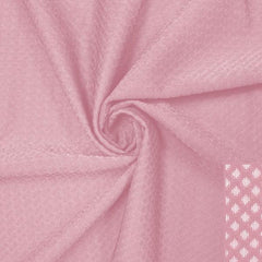 A swirled piece of Hive Textured Spandex in the color shabby chic.