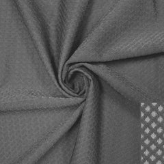 A swirled piece of Hive Textured Spandex in the color slate gray.