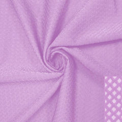 A swirled piece of Hive Textured Spandex in the color spring fairy.