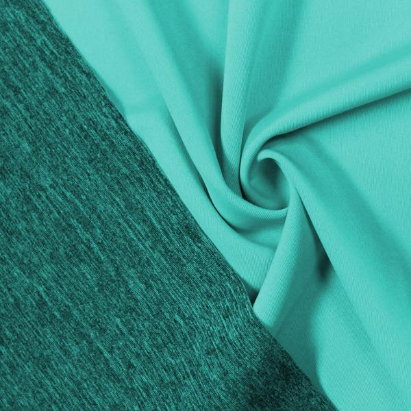 A swirled piece of Karma Double-Sided Heather Spandex in the color aqua tides.