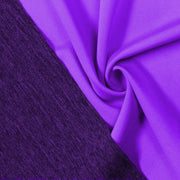 A swirled piece of Karma Double-Sided Heather Spandex in the color electric purple.