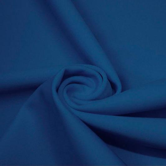 A swirled piece of matte nylon spandex fabric in the color abyss blue.
