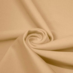 A swirled piece of matte nylon spandex fabric in the color almond.