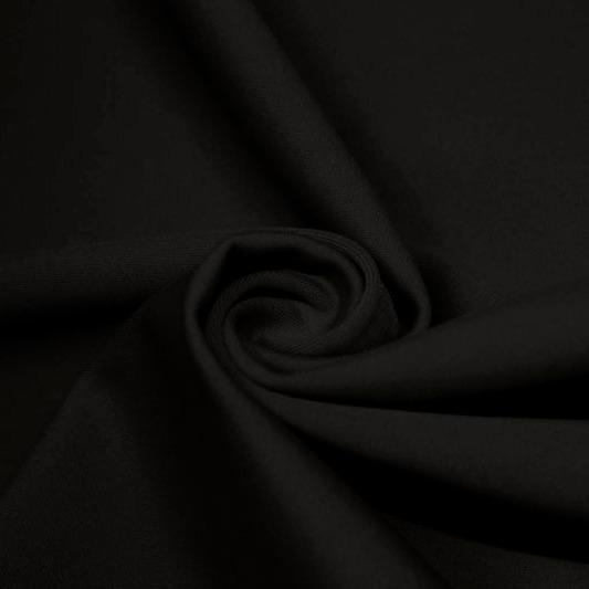 A swirled piece of matte nylon spandex fabric in the color black.