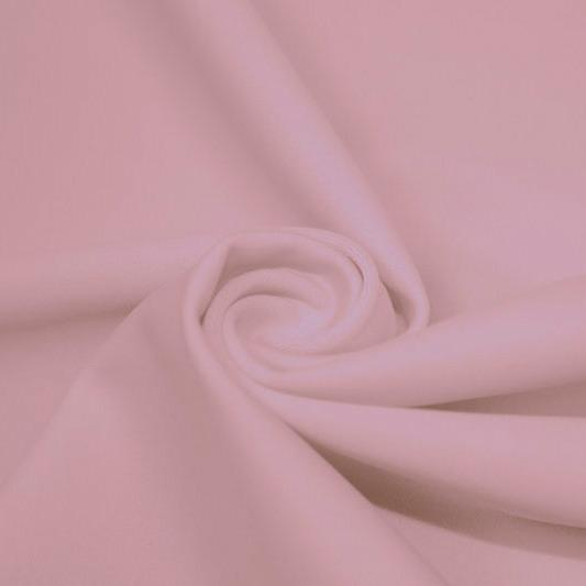 A swirled piece of matte nylon spandex fabric in the color blush.