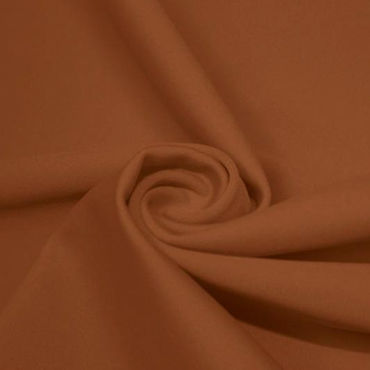 A swirled piece of matte nylon spandex fabric in the color bronze.