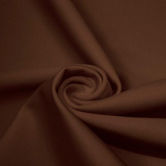 A swirled piece of matte nylon spandex fabric in the color brown.