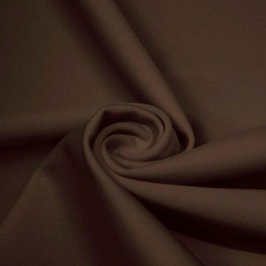A swirled piece of matte nylon spandex fabric in the color brown sugar.