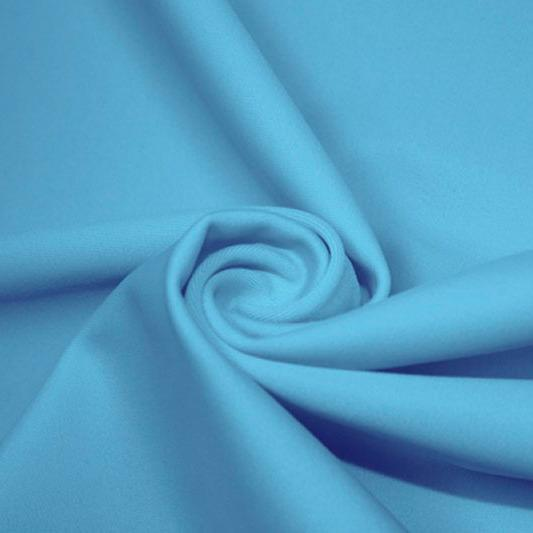 A swirled piece of matte nylon spandex fabric in the color celeste blue.