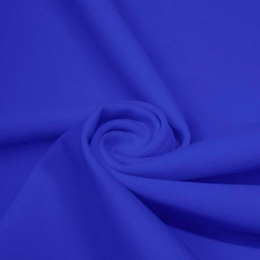 A swirled piece of matte nylon spandex fabric in the color cerulean.
