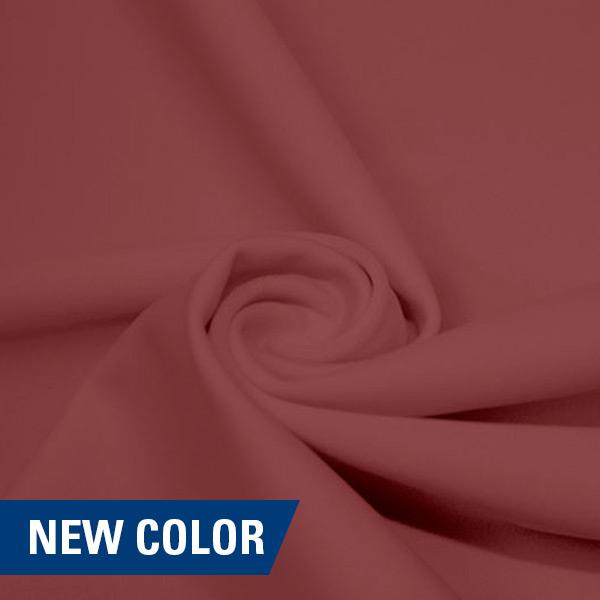 A swirled piece of matte nylon spandex fabric in the color champagne.