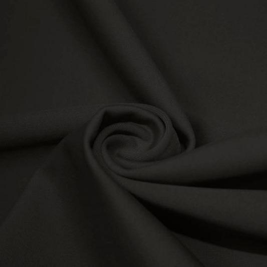 A swirled piece of matte nylon spandex fabric in the color charcoal.