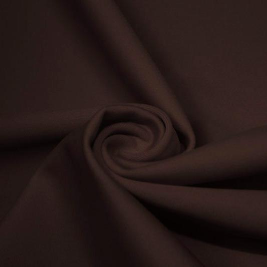 A swirled piece of matte nylon spandex fabric in the color dark brown.