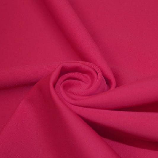 A swirled piece of matte nylon spandex fabric in the color dark magenta.
