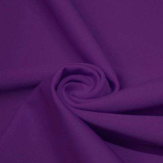 A swirled piece of matte nylon spandex fabric in the color dark purple.