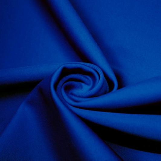 A swirled piece of matte nylon spandex fabric in the color deep royal.