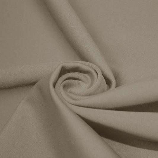A swirled piece of matte nylon spandex fabric in the color dust.