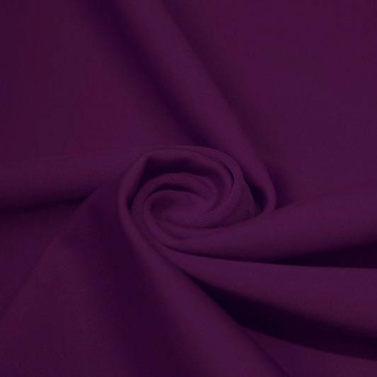 A swirled piece of matte nylon spandex fabric in the color eggplant.