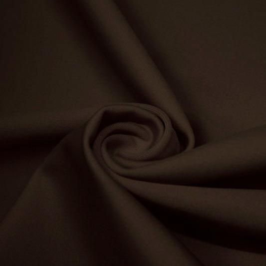 A swirled piece of matte nylon spandex fabric in the color espresso.