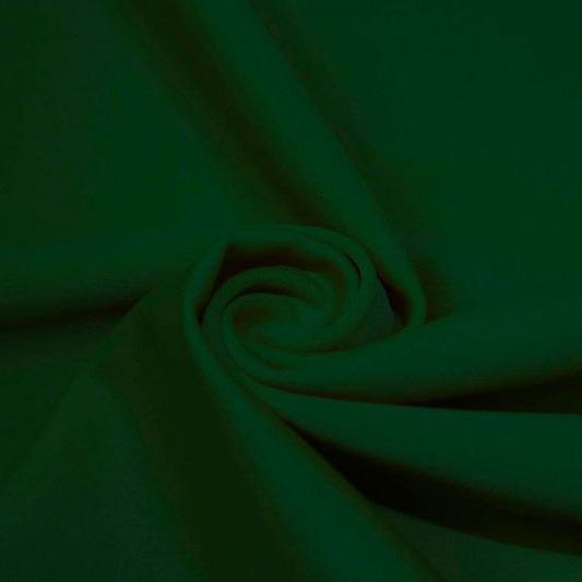 A swirled piece of matte nylon spandex fabric in the color evergreen.