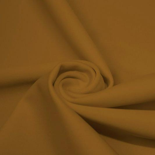 A swirled piece of matte nylon spandex fabric in the color golden.