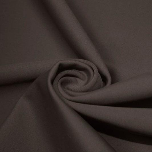 A swirled piece of matte nylon spandex fabric in the color graphite.