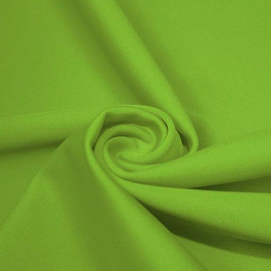 A swirled piece of matte nylon spandex fabric in the color grass.