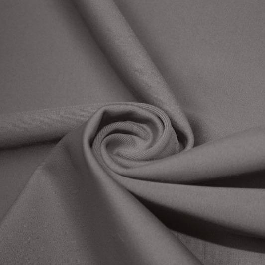 A swirled piece of matte nylon spandex fabric in the color gray.