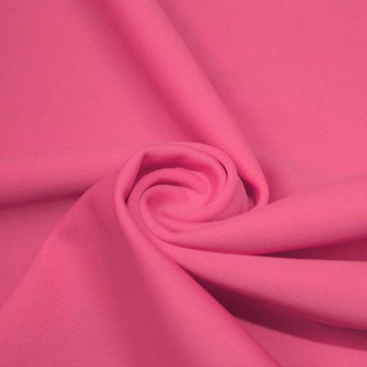A swirled piece of matte nylon spandex fabric in the color guava.