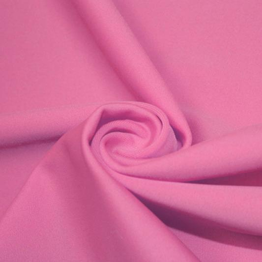 A swirled piece of matte nylon spandex fabric in the color hot pink.