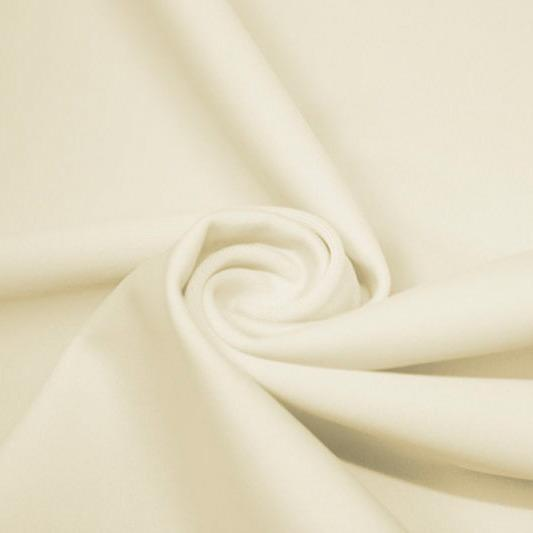 A swirled piece of matte nylon spandex fabric in the color ivory.