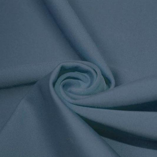 A swirled piece of matte nylon spandex fabric in the color jean.