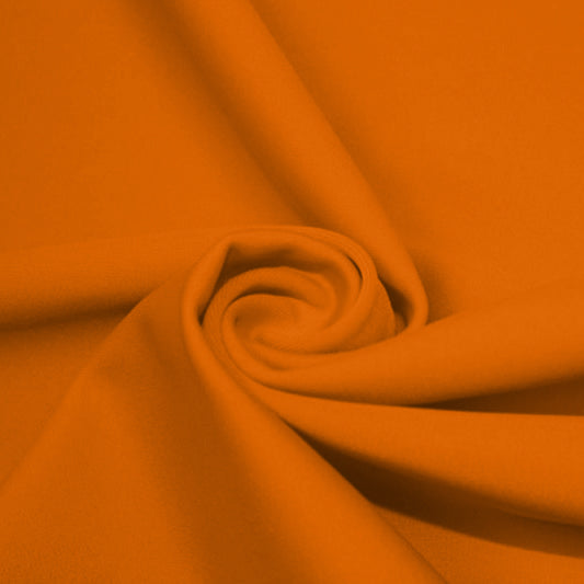 A swirled piece of matte nylon spandex fabric in the color juicy tangerine.