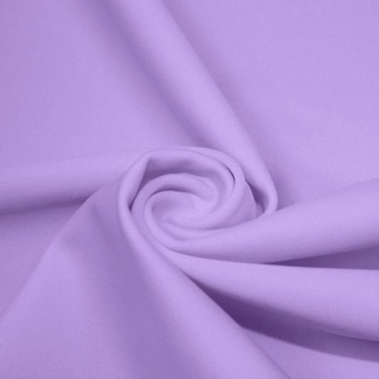 A swirled piece of matte nylon spandex fabric in the color lilac.