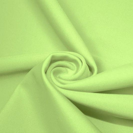 A swirled piece of matte nylon spandex fabric in the color lucky charm.