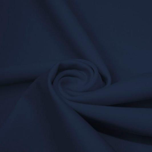 A swirled piece of matte nylon spandex fabric in the color marine navy.
