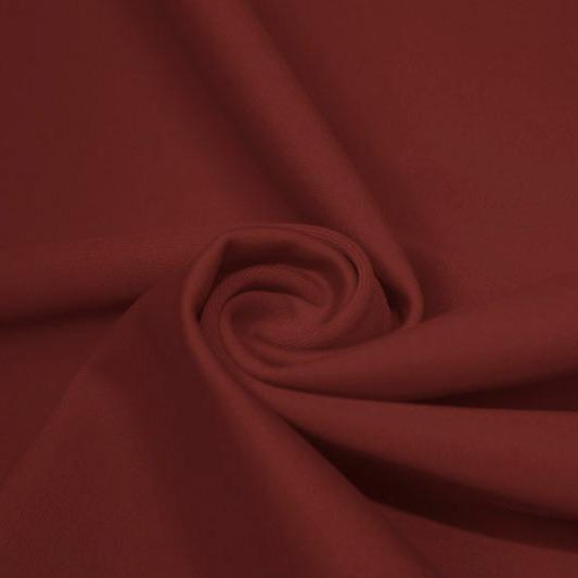 A swirled piece of matte nylon spandex fabric in the color mars.