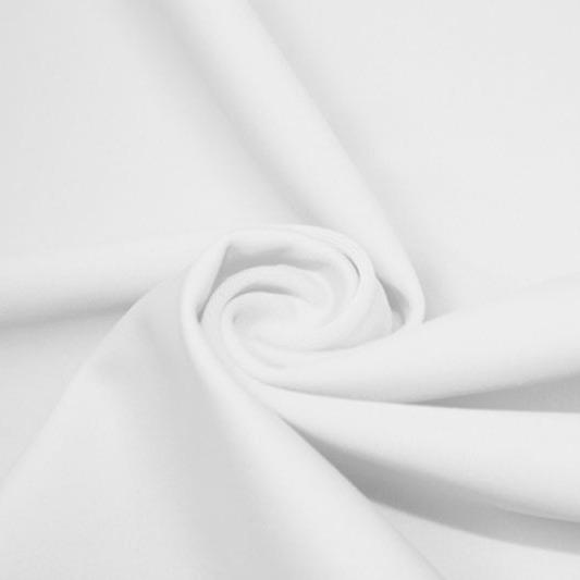 A swirled piece of matte nylon spandex fabric in the color martini white.
