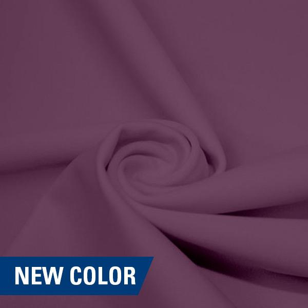A swirled piece of matte nylon spandex fabric in the color melody.