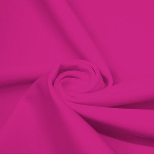 A swirled piece of matte nylon spandex fabric in the color mixed pink.
