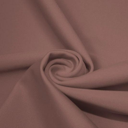 A swirled piece of matte nylon spandex fabric in the color mocha.