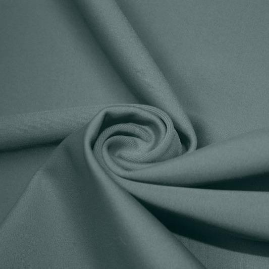 A swirled piece of matte nylon spandex fabric in the color moonstone blue.
