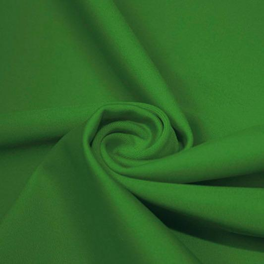 A swirled piece of matte nylon spandex fabric in the color moss.