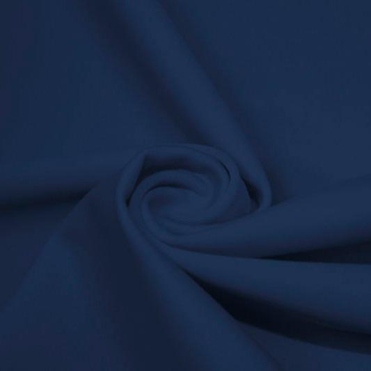 A swirled piece of matte nylon spandex fabric in the color navy.