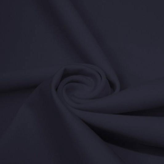 A swirled piece of matte nylon spandex fabric in the color navy blue.