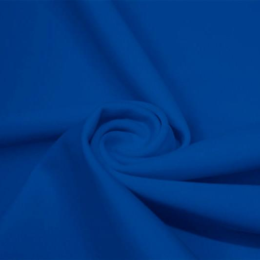A swirled piece of matte nylon spandex fabric in the color new royal.