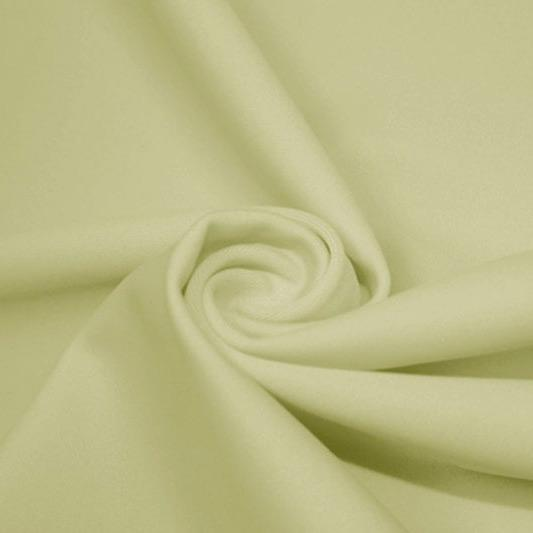A swirled piece of matte nylon spandex fabric in the color pearl.