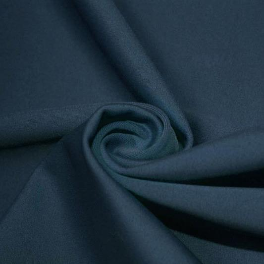 A swirled piece of matte nylon spandex fabric in the color pebble.