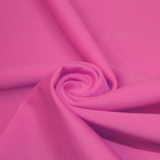 A swirled piece of matte nylon spandex fabric in the color pink panther.